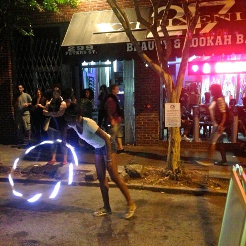 Hula-hooper on Peters St.